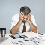 Frustrated Man Worries About Economy, Unpaid Bills and Retirement